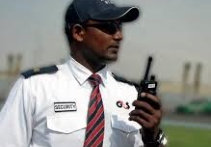 A security Guard in a white uniform