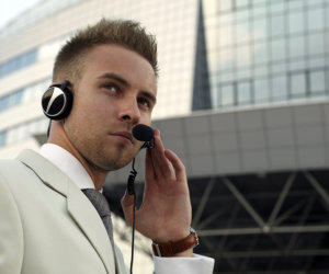 security guard having a call using his headphone