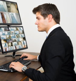 man looking at a screen